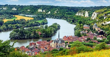 """The 10-day cruise tour """"Paris & Normandy"""" begins and ends in Paris and ventures farther down the Seine. In addition to perusing museums and masterpieces in the world's most romantic city, excursions include the essential experiences of stepping foot on Normandy's D-Day beaches and visiting the Giverny gardens which inspired Claude Monet. In the medieval city of Rouen, you may choose to explore on your own, courtesy of AmaWaterways' complimentary bicycles."""